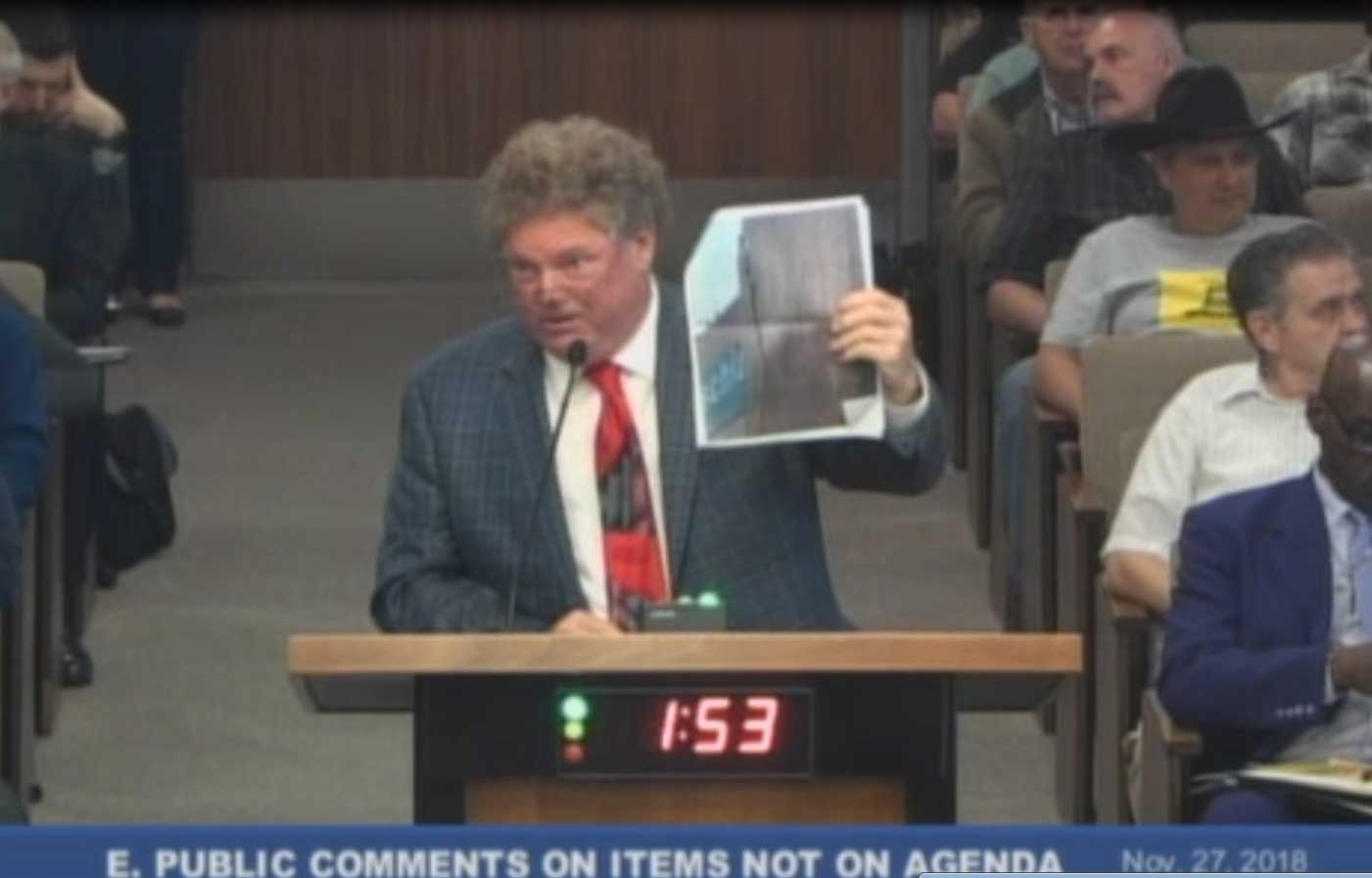 Tom Peterson presents letters and images to City Council